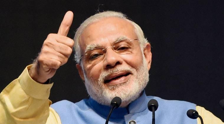 New Delhi: Prime Minister Narendra Modi addressing at the launch of a new mobile app 'BHIM' to encourage e-transactions during the ''Digital Mela'' at Talkatora Stadium in New Delhi on Friday.  PTI Photo by Subhav Shukla (PTI12_30_2016_000126A)